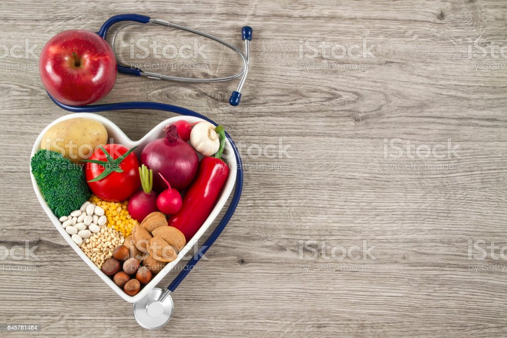 Healthy Foods with Stethoscope on Wood Background stock photo