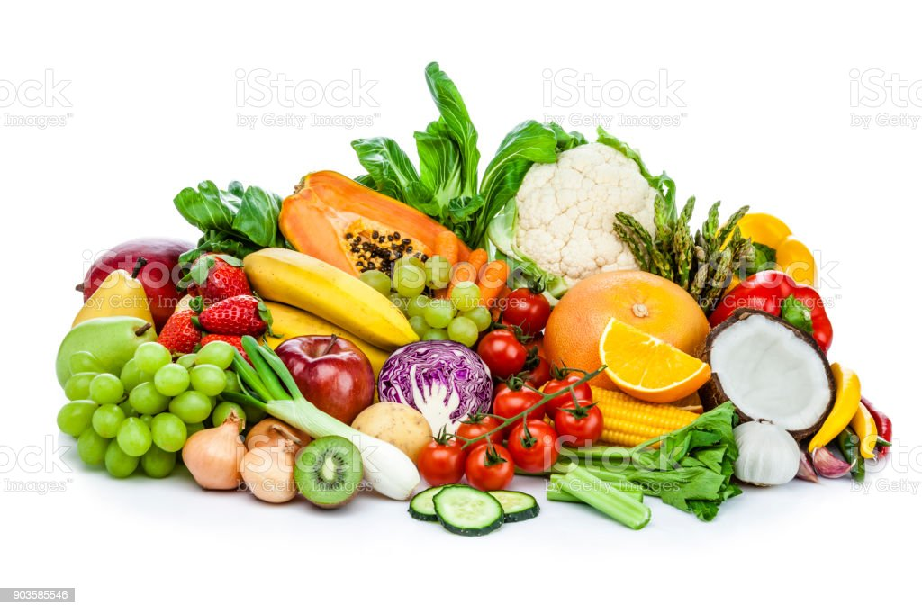 Healthy fresh fruits and vegetables heap isolated on white background stock photo