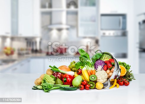 istock Healthy fresh fruits and vegetables on kitchen counter top 1147505264