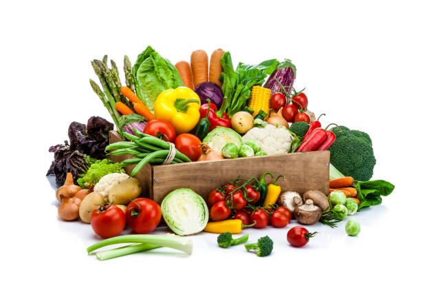 healthy fresh vegetables in a wooden crate isolated on white background - kapustowate zdjęcia i obrazy z banku zdjęć