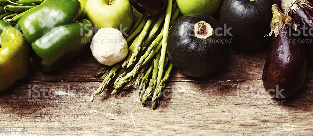 Healthy fresh vegetables, including eggplant and asparagus, on wood royalty-free stock photo
