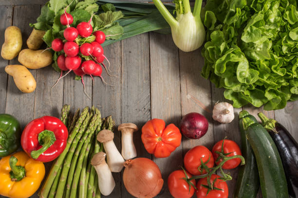 Healthy fresh vegetables on rustic wood Healthy fresh vegetables on rustic wood for a nutritional concept vielfalt stock pictures, royalty-free photos & images