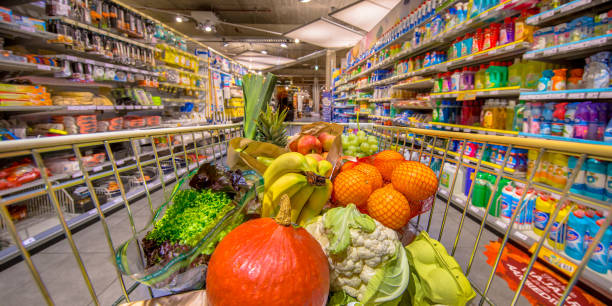 Healthy Fruit and vegetables in Grocery shop cart Healthy Fruit and vegetables in Grocery shop cart in supermarket filled with food products as seen from the customers point of view supermarket stock pictures, royalty-free photos & images