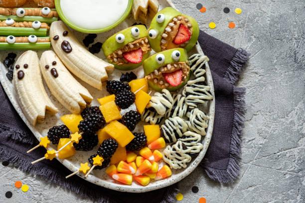 healthy fruit halloween treats. - halloween candy стоковые фото и изображения