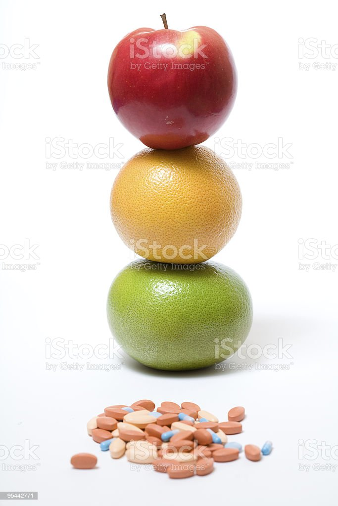 healthy fruits and pills royalty-free stock photo