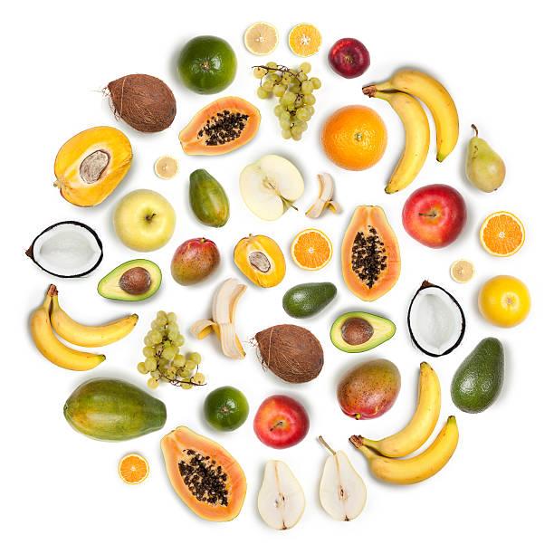 healthy fruits arranged in a round composition on white background - hindistan cevizi tropik meyve stok fotoğraflar ve resimler