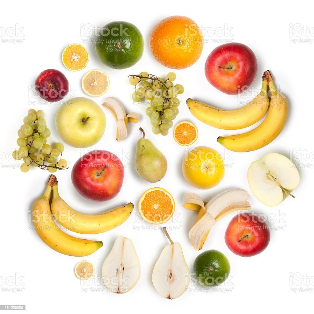 Healthy fruits circular arrangement, white background:  apples, bananas, lemons stock photo