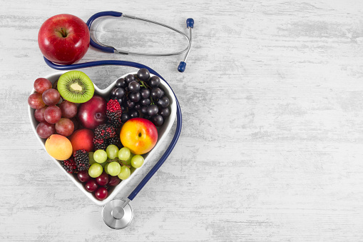 Healthy Fruits in Heart Shaped Plate with Stethoscope