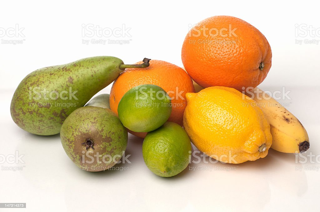 Healthy fruits on the white reflective table. stock photo