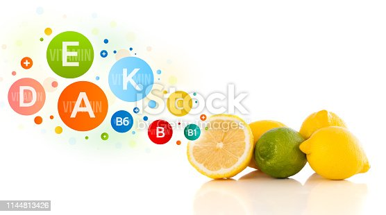 istock Healthy fruits with colorful vitamin symbols and icons 1144813426