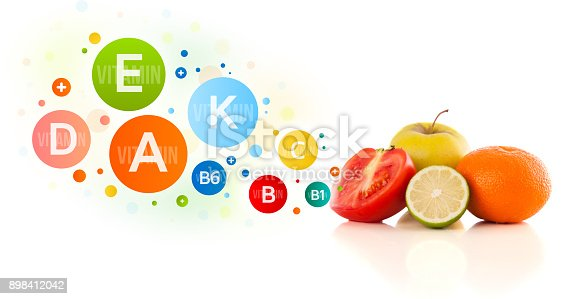 istock Healthy fruits with colorful vitamin symbols and icons 898412042