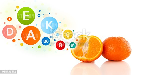 istock Healthy fruits with colorful vitamin symbols and icons 988139372