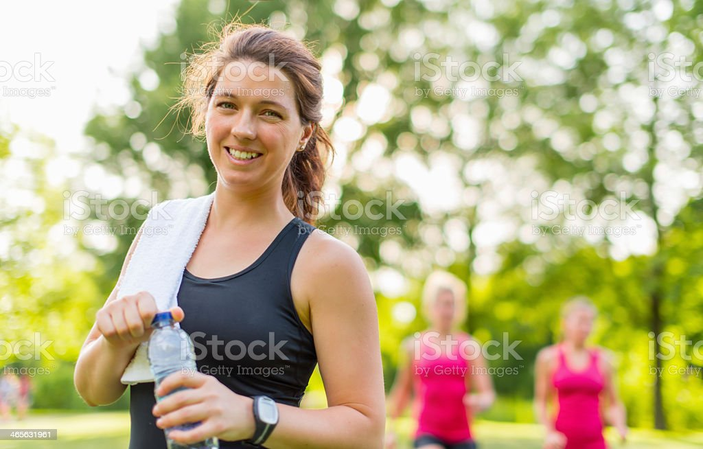 Healthy girl holding a water bottle stock photo