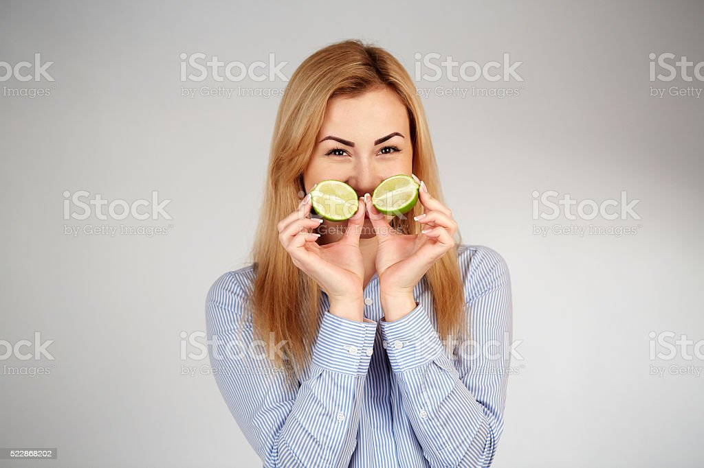 Healthy girl in diferent emotions, with lime stock photo