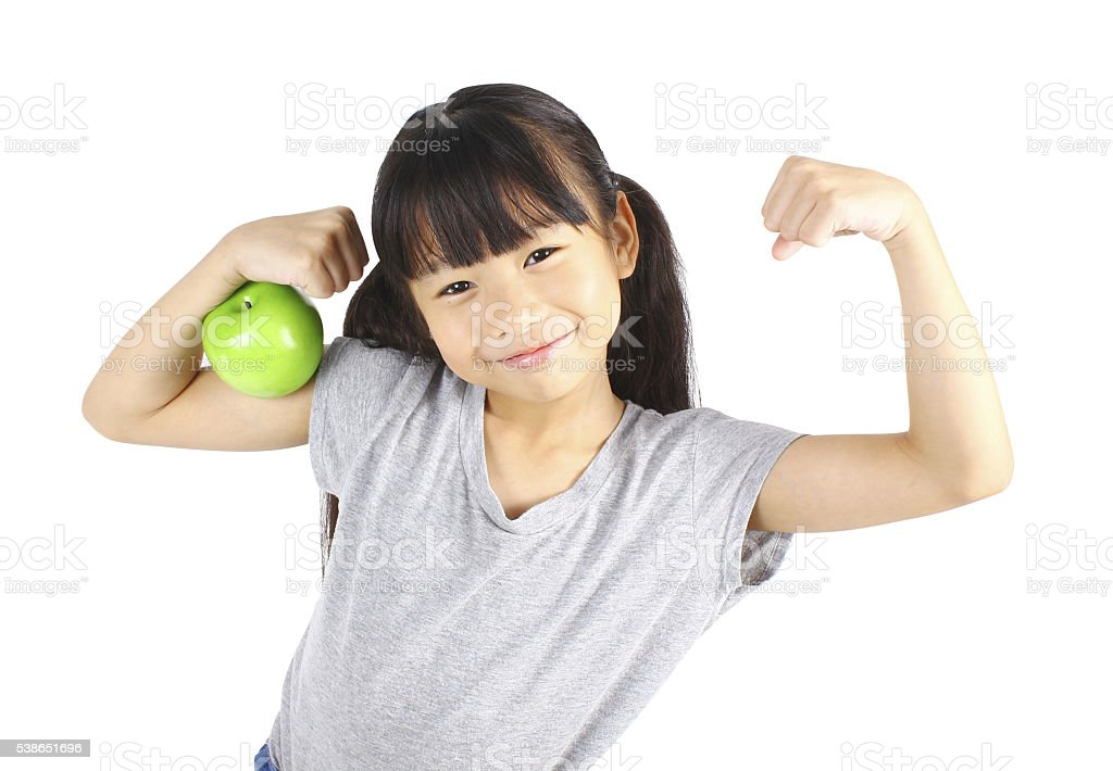 Healthy girl with green apple stock photo