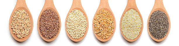 Healthy grains and seeds on white background stock photo
