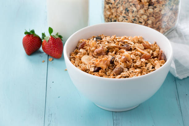 Healthy granola breakfast with fruits stock photo