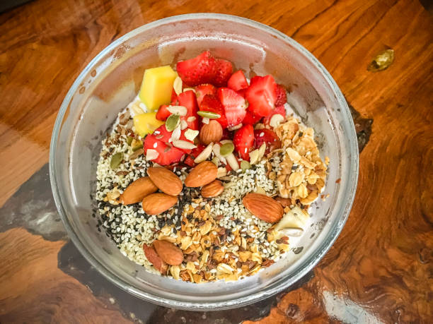 Healthy granola with mix fruits, nuts and seeds stock photo