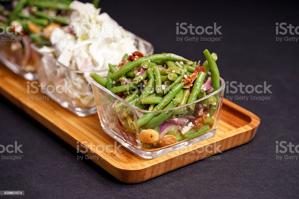 Healthy green beans salad and tasty Waldorf stock photo