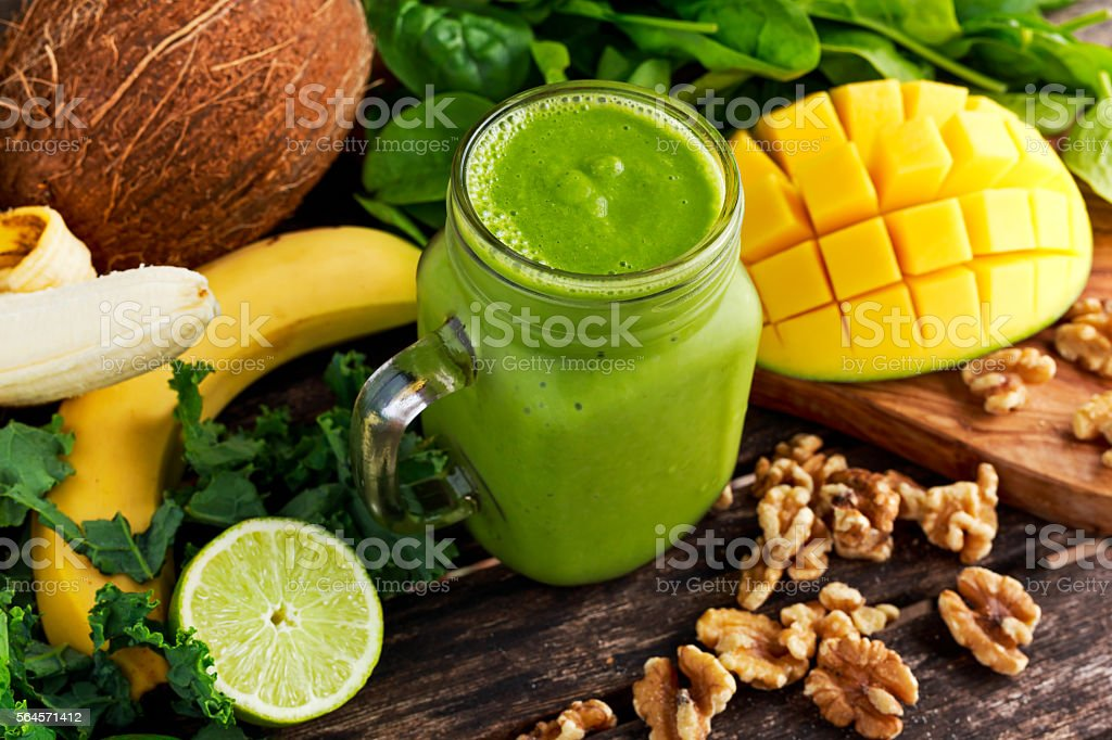 Healthy Green Reach Vitamins Smoothie with baby leaf spinach, kale - Photo