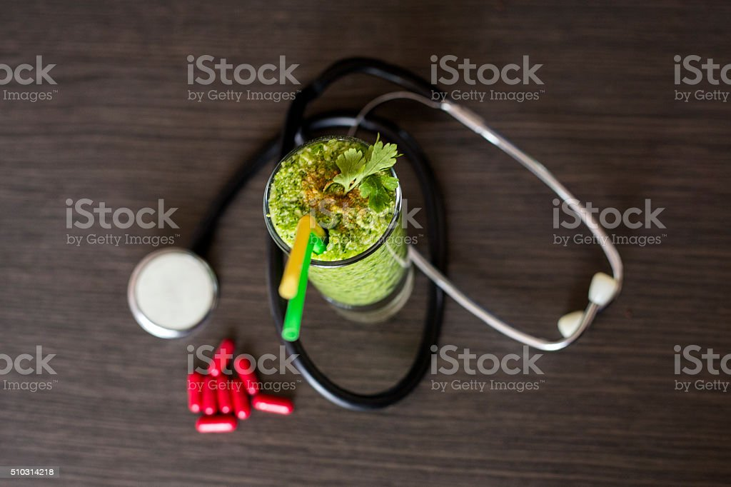 Healthy green smoothie and cholesterol diet concept stock photo