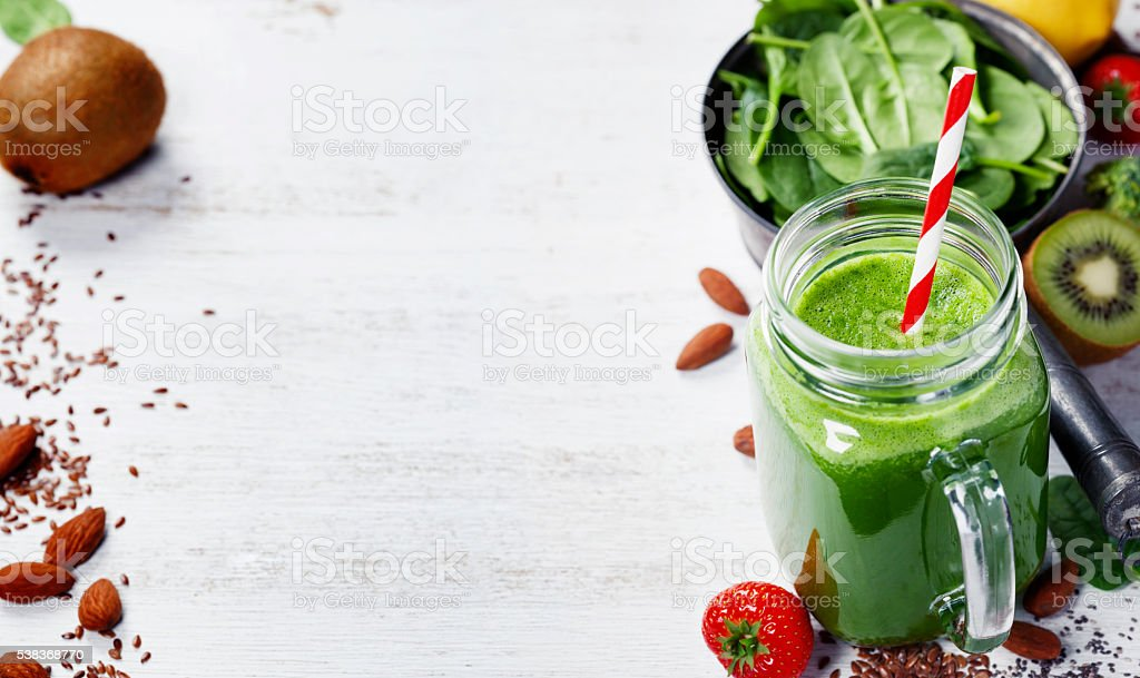 Healthy green smoothie and ingredients stock photo