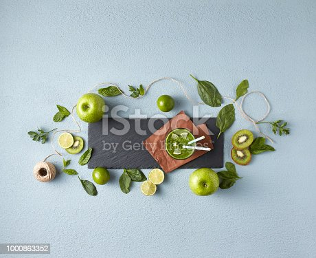 istock Healthy green smoothie in glass jar, top view 1000863352