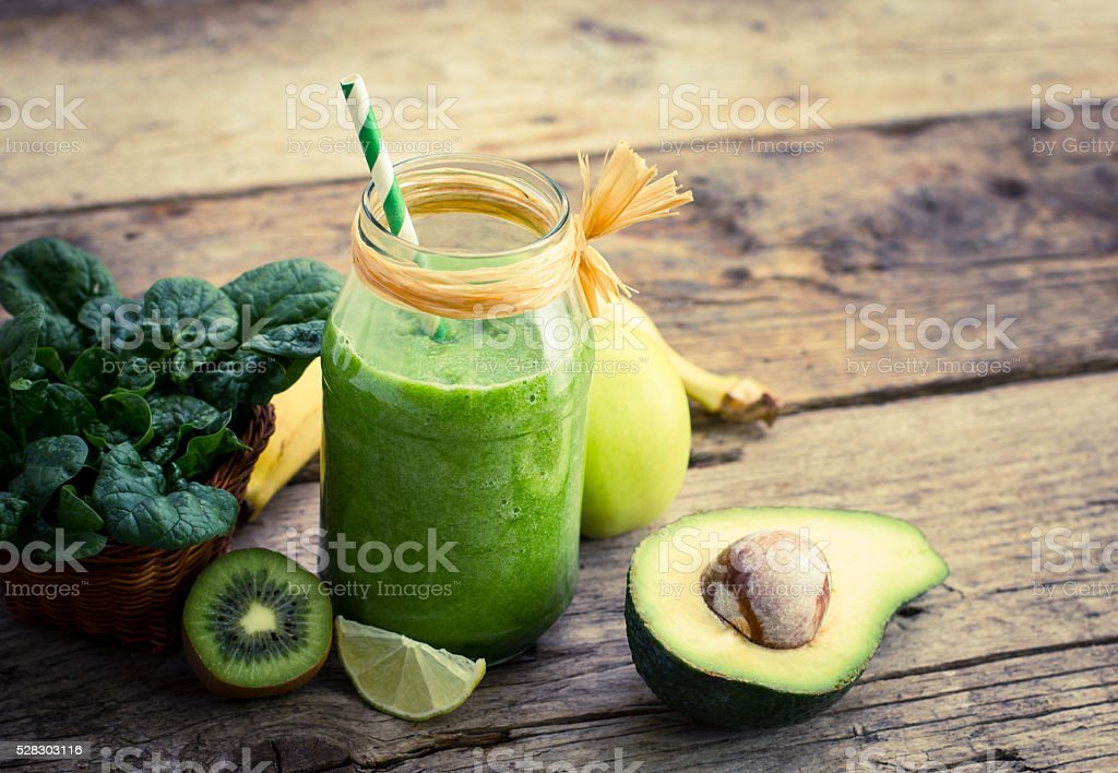 Healthy green smoothie in the jar stock photo