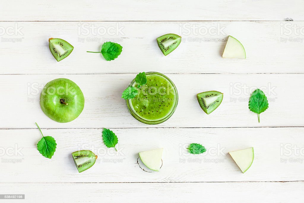 healthy green smoothie of apples and kiwifruit stock photo