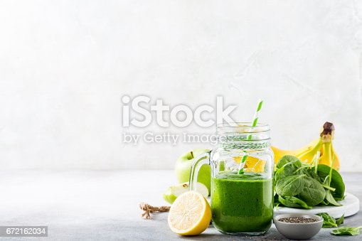 istock Healthy green smoothie with spinach in glass jar 672162034