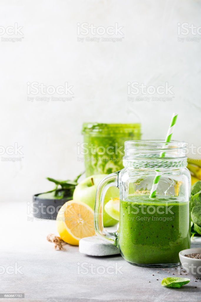Healthy green smoothie with spinach in glass jar royalty-free stock photo
