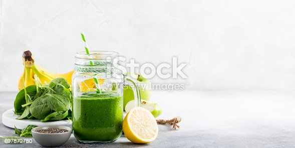 istock Healthy green smoothie with spinach in glass jar 697872780