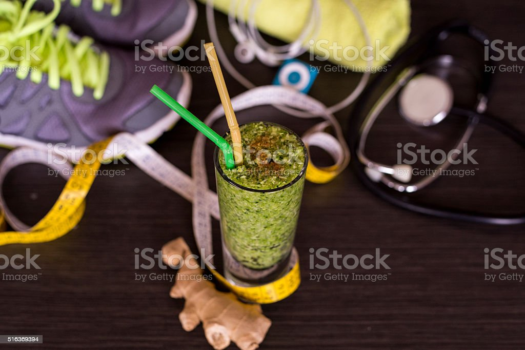 Healthy green smoothie with Sport equipment stock photo