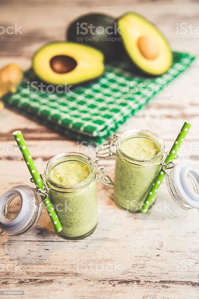 Healthy green smoothies and avocado stock photo