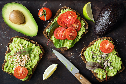 Healthy green veggie avocado toast with sprouts