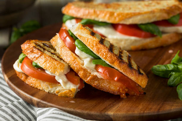 healthy grilled basil mozzarella caprese panini - vegetarian stock photos and pictures