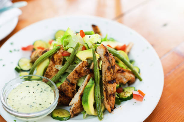 Healthy grilled chicken salad Chicken salad on a restaurant table. salad dressing stock pictures, royalty-free photos & images