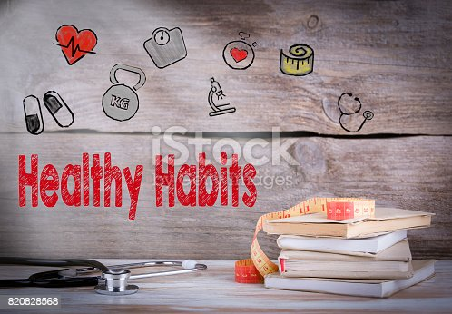 istock Healthy habits Concept. Stack of books and a stethoscope on a wo 820828568