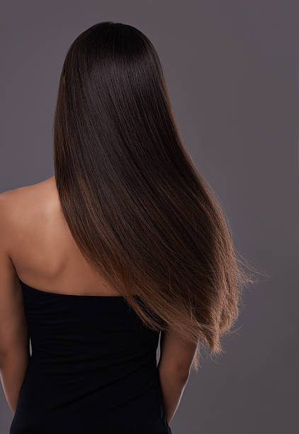 Healthy hair at it's best! Rear view of a young woman with beautiful long hair straight hair stock pictures, royalty-free photos & images