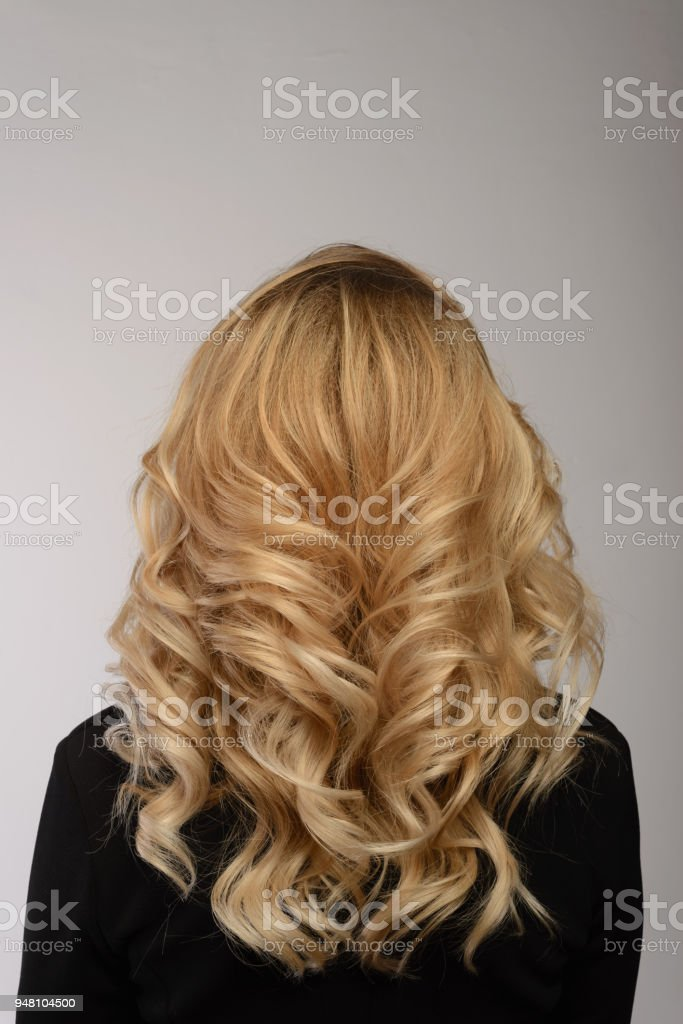 Healthy hair. Curly long hairstyle. Back view of Blond hairs. stock photo