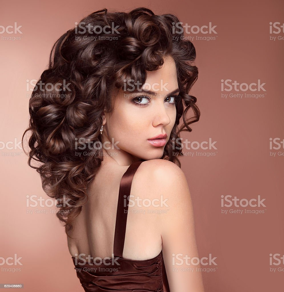 Healthy Hair. Makeup. Beauty brunette portrait. Attractive girl stock photo