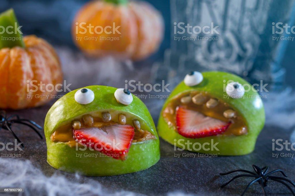 Healthy Halloween Apple Monsters Fruit Kids Treat stock photo