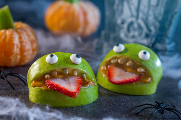 Healthy Halloween Apple Monsters Fruit Kids Treat stock photo