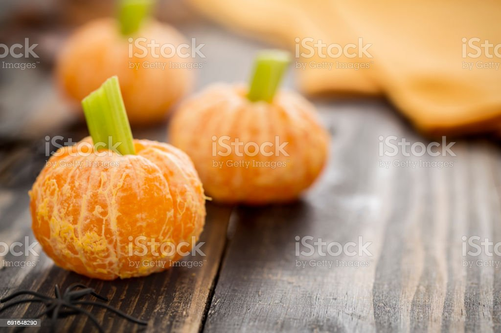 Healthy Halloween Food - Tangerine Pumpkins Snack Kids stock photo