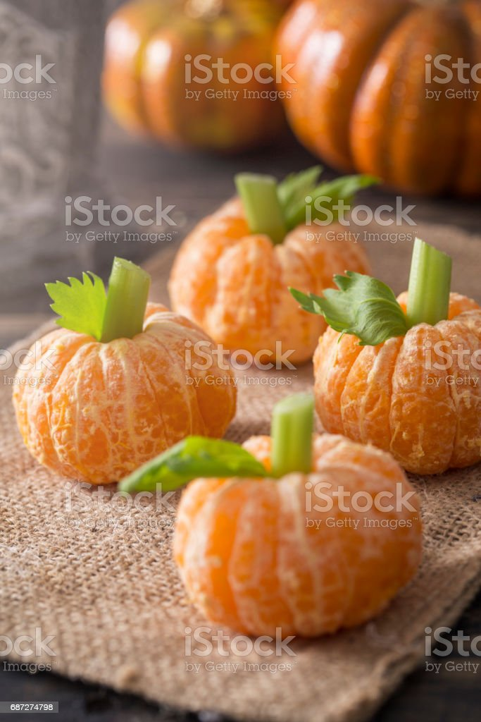 Healthy Halloween Treats Tangerine Pumpkin Kids Fun stock photo