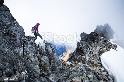 Healthy happy woman mountain hiking in the North Cascades in Washington State