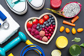 istock Healthy heart  diet and sport gym equipment concept on blackboard 909488554