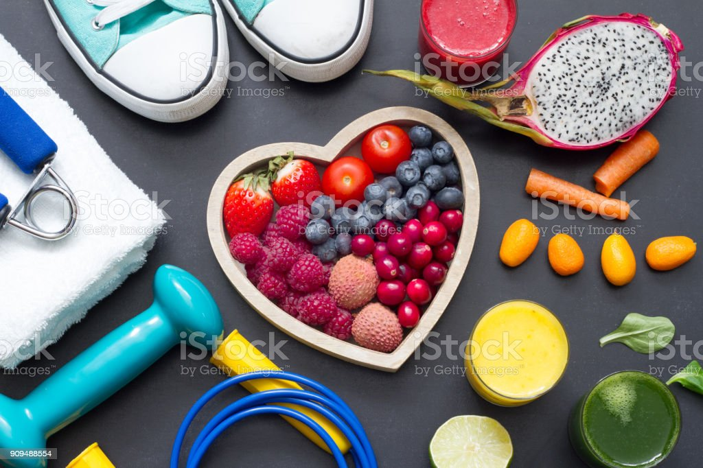 Healthy heart  diet and sport gym equipment concept on blackboard stock photo