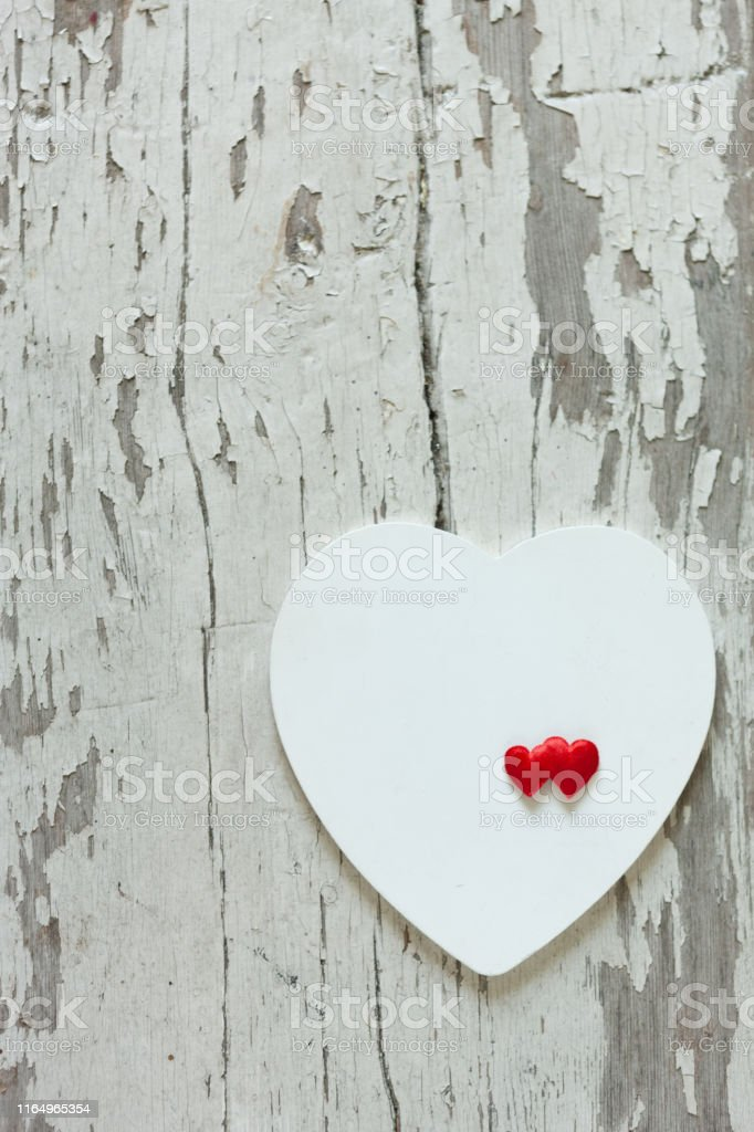 Healthy Heart on the white wooden heart symbol background