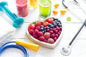 istock Healthy heart stethoscope diet and sport gym equipment concept on white background 909488458